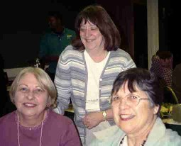 (Clockwise from top) Cathy Woolbright, Linda Venis, and Sharon Cann share a laugh during the ILL Forum.