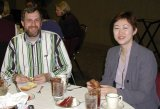 Mike Shadix (left) and Mia Sohn-White enjoy the food & entertainment provided at the 2001 banquet.